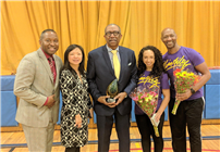 Photo of Alvin Ailey dancers and Faison with Principal and Assistant Principal